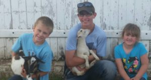 2016 IDGA Share-A-Kid winner Gavin Johnson with donors JJ Livestock, McDaniel Family
