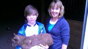 2015 IDGA Share-A-Kid Winner Garrett Gorczynski and donor Pam Clapp of Stargazer Goats