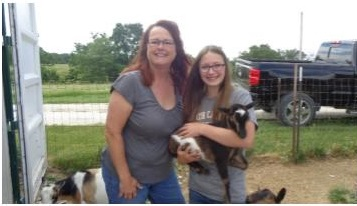 IDGA Share A Kid winner Alex with donor Ann Alecock Two Dogs Farms