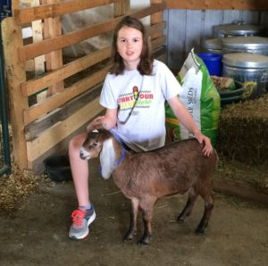 IDGA Share-A-Kid winner with nubian doeling from Ballasalla Nubians
